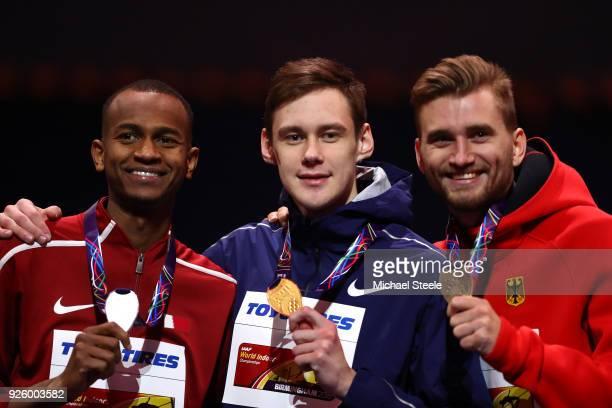 Gold Medallist Danil Lysenko of Authorised Neutral Athlete Bronze Medallist Mateusz Przybylko of Germany and Silver Medallist Mutaz Essa Barshim of...