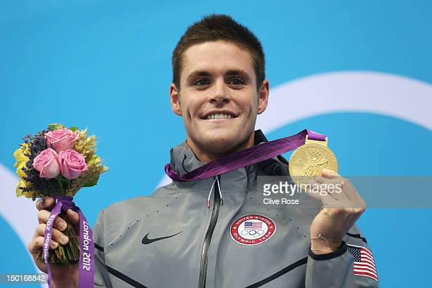 Gold medallist David Boudia of the United States poses on the podium during the medal ceremony for the Men's 10m Platform Diving Final on Day 15 of...