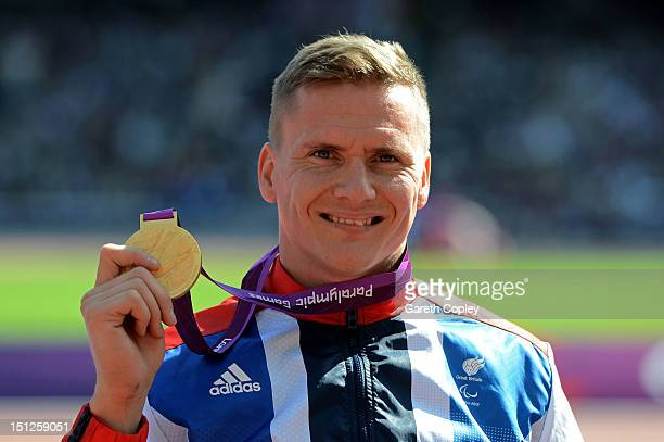 Gold medallist David Weir of Great Britain poses on the podium during the medal ceremony for the Men's 1500m - T54 finalon day 7 of the London 2012...
