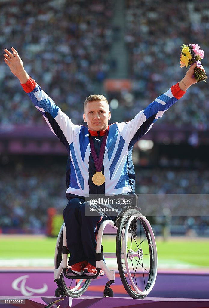 Gold medallist David Weir of Great Britain poses on the podium during the medal ceremony for the Men's 1500m - T54 finalon day 7 of the London 2012 Paralympic Games at Olympic Stadium on September 5, 2012 in London, England.