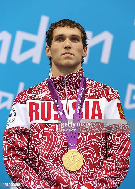 Gold medallist Denis Tarasov of Russia poses on the podium during the medal ceremony for the Men's 50m Freestyle S8 final on day 5 of the London 2012...