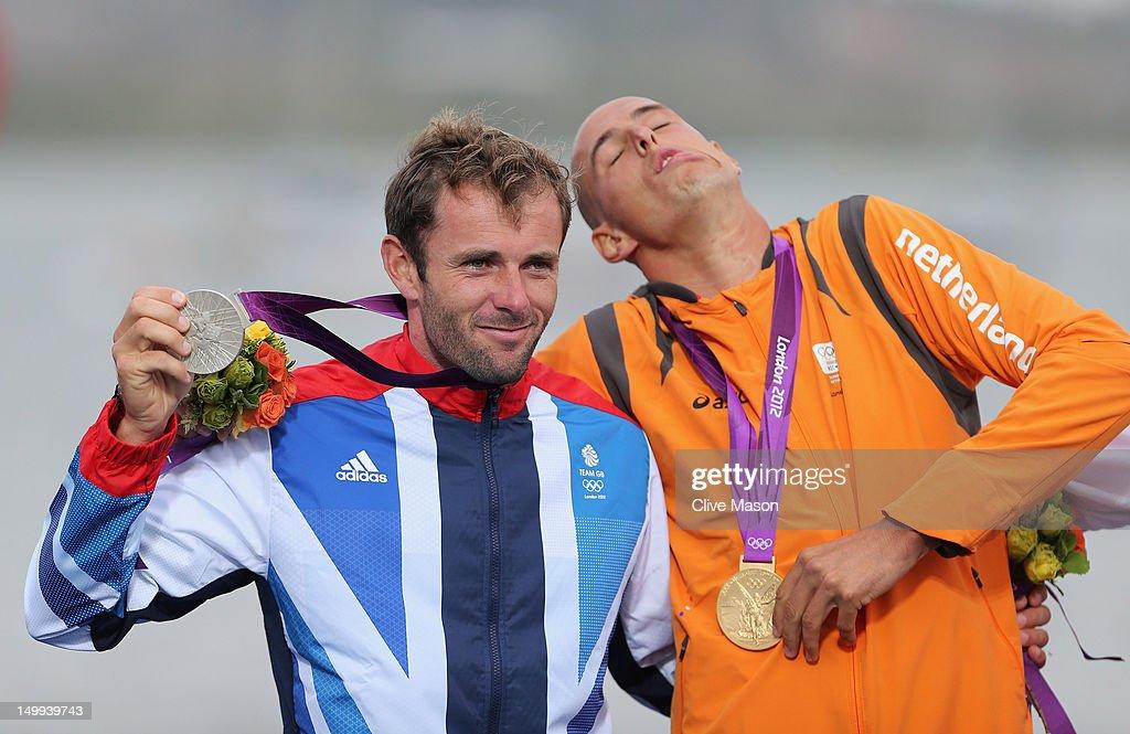 Gold medallist Dorian Van Rijsselberge (R) of Netherlands celebrates with silver medallist Nick Dempsey of Great Britain following the Men's
