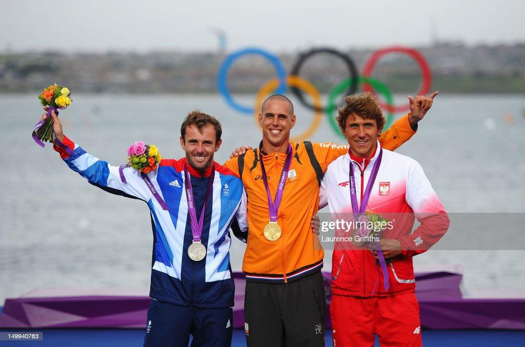 Gold medallist Dorian Van Rijsselberge (C) of Netherlands celebrates with silver medallist Nick Dempsey (L) of Great Britain and bronze medallist Przemyslaw Miarczynski (R) of Poland following the Men's