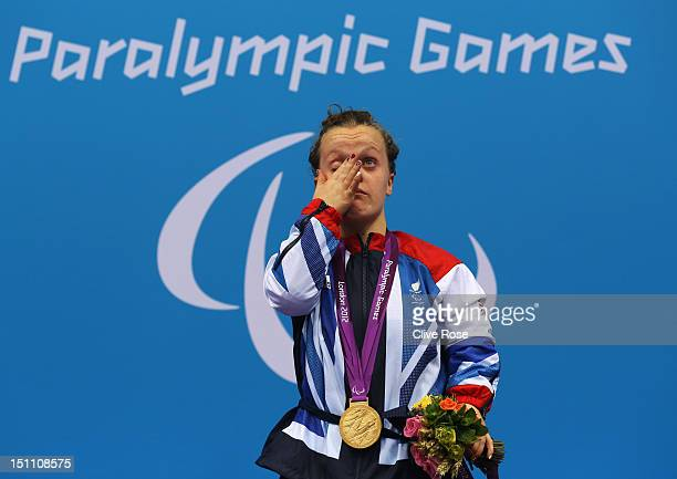 Gold medallist Eleanor Simmonds of Great Britain wipes away a tear during the medal ceremony for the Women's 400m Freestyle S6 Final on day 3 of the...