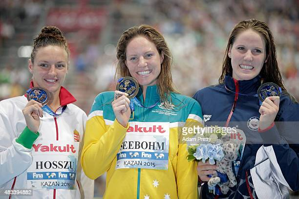 Gold medallist Emily Seebohm of Australia poses with silver medallist Missy Franklin of the United States and bronze medallist Katinka Hosszu of...