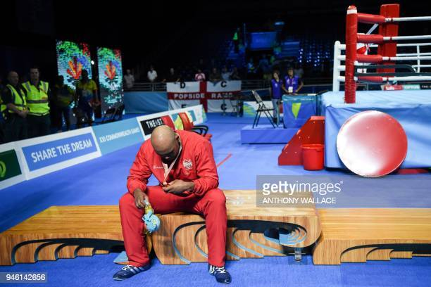 TOPSHOT Gold medallist England's Frazer Clarke rests after his win over India's Satish Kumar during their men's 91kg final boxing match during the...