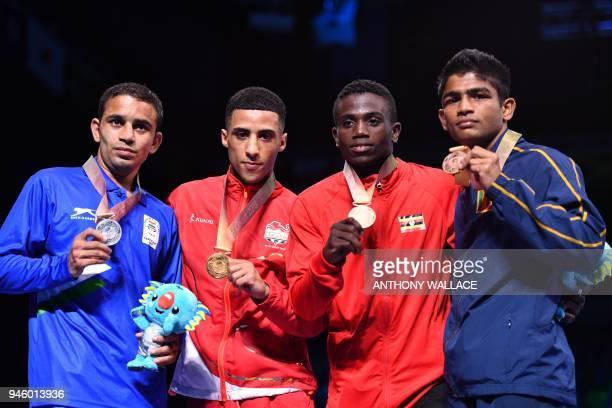Gold medallist England's Galal Yafai poses with silver medallist India's Amit and bronze medallists Uganda's Juma Miiro and Sri Lanka's Thiwanka...