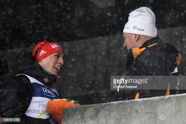 Gold medallist Eric Frenzel of Germany is congratulated by King Harald V of Norway following the Nordic Combined Individual 10KM Cross Country race...