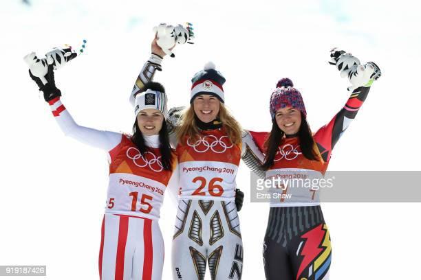 Gold medallist Ester Ledecka of the Czech Republic celebrates with silver medallist Anna Veith of Austria and bronze medallist Tina Weirather of...
