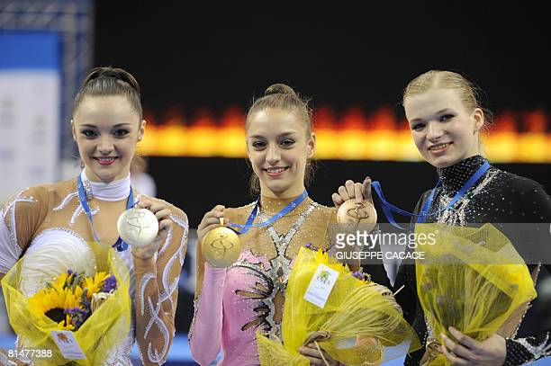 Gold medallist Eugenia Kanaeva of Russia , Silver medallist Anna Bessanova of Ukraina and Olga Kapranova of Russia who too thr bronze medal celebrate...