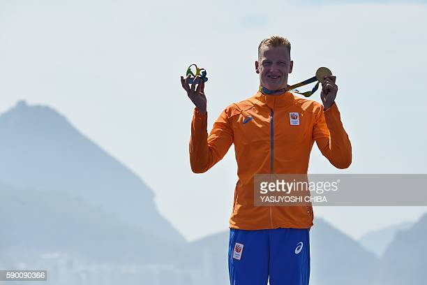 Gold medallist Ferry Weertman of Netherland's poses during the podium ceremony of the Men's 10km marathon swimming in Copacabana on August 16 2016...