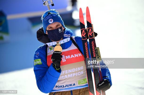 Gold medallist France's Emilien Jacquelin poses with his medal after the Men's 12,5 km Pursuit event at the IBU Biathlon World Championships in...