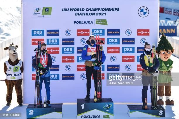 Gold medallist France's Emilien Jacquelin , silver medallist Sweden's Sebastian Samuelsson and bronze medallist Norway's Johannes Thingnes Boe pose...