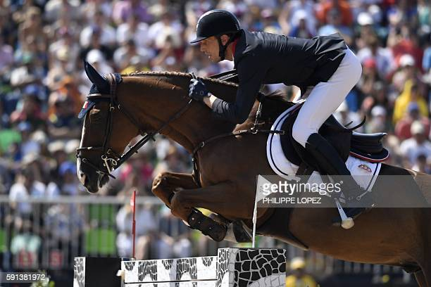 Gold medallist France's Kevin Staut riding Reveur de Hurtebise competes during the jumping competition at the Olympic Equestrian Centre during the...