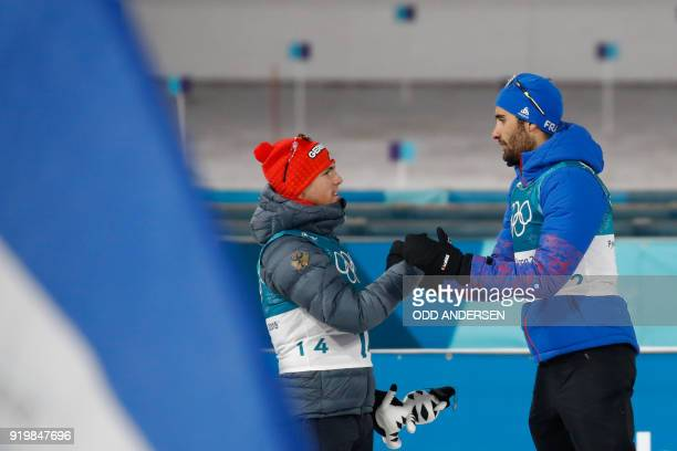 TOPSHOT Gold medallist France's Martin Fourcade congratulates silver medallist Germany's Simon Schempp as they celebrate on the podium during the...