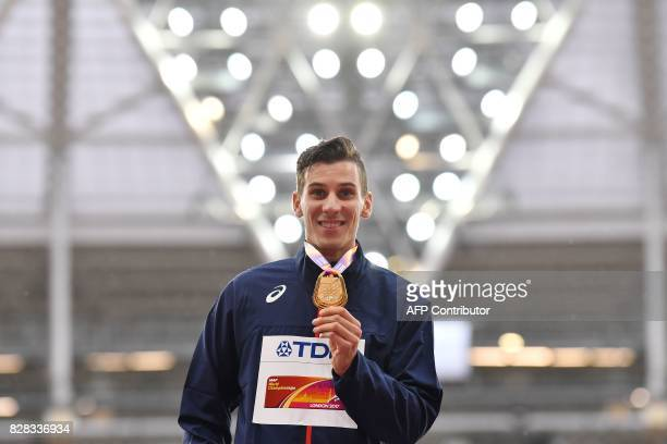 Gold medallist France's Pierre-Ambroise Bosse poses on the podium during the victory ceremony for the men's 800m athletics event at the 2017 IAAF...
