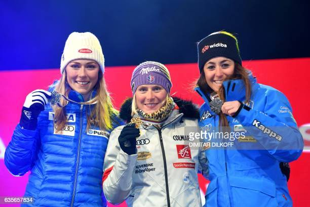 Gold medallist France's Tessa Worley silvermedallist US skier Mikaela Shiffrin and bronze medallist Italy's Sofia Goggia pose on the podium of the...