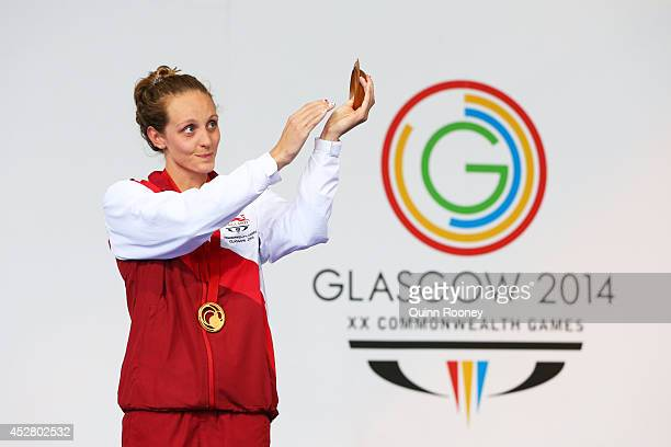 Gold medallist Francesca Halsall of England applauds the fans during the medal ceremony for the Women's 50m Butterfly Final at Tollcross...