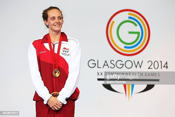 Gold medallist Francesca Halsall of England poses during the medal ceremony for the Women's 50m Butterfly Final at Tollcross International Swimming...