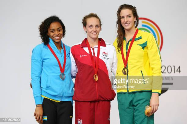 Gold medallist Francesca Halsall of England poses with silver medallist Arianna Vanderpool Wallace of Bahamas and bronze medallist Brittany Elmslie...