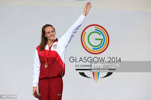 Gold medallist Francesca Halsall of England stands on the podium during the medal ceremony for the Women's 50m Freestyle Final at Tollcross...