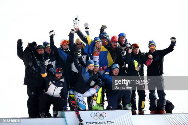 Gold medallist Frida Hansdotter of Sweden celebrates with her team during the victory ceremony for the Ladies' Slalom Alpine Skiing at Yongpyong...