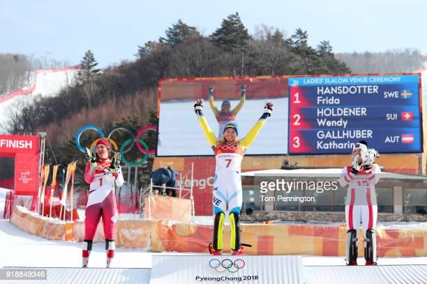 Gold medallist Frida Hansdotter of Sweden celebrates with silver medallist Wendy Holdener of Switzerland and bronze medallist Katharina Gallhuber of...