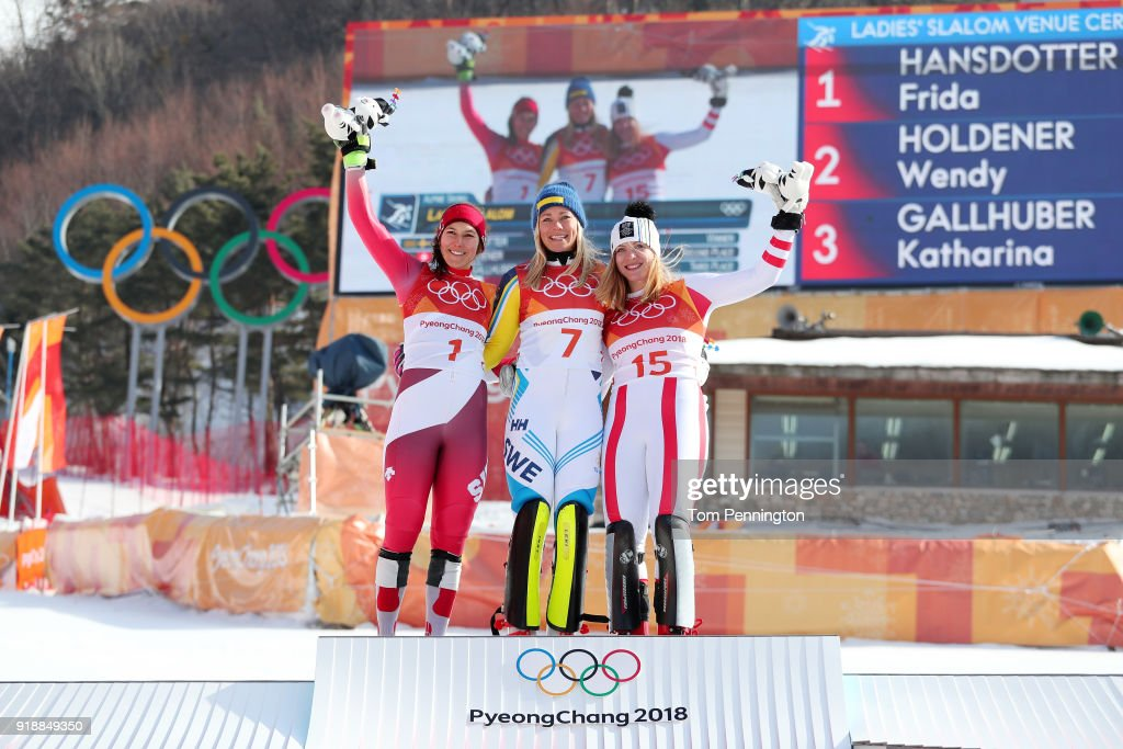 Gold medallist Frida Hansdotter (C) of Sweden celebrates with silver medallist Wendy Holdener (L) of Switzerland and bronze medallist Katharina Gallhuber of Austria during the victory ceremony for the Ladies' Slalom Alpine Skiing at Yongpyong Alpine Centre on February 16, 2018 in Pyeongchang-gun, South Korea.