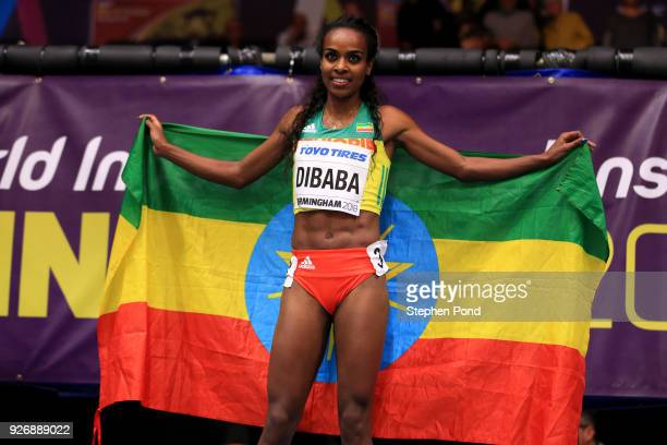Gold Medallist Genzebe Dibaba celebrates after the 1500 Metres Womens Final during the IAAF World Indoor Championships on Day Three at Arena...