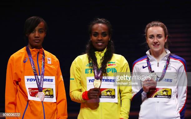 Gold Medallist, Genzebe Dibaba of Ethopia Silver Medallist, Sifan Hassan of Netherlands and Bronze Medallist, Laura Muir of Great Britian celebrate...