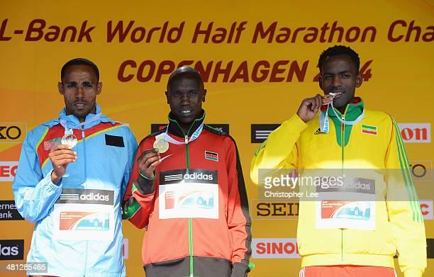 Gold medallist Geoffrey Kipsang Kamworor of Kenya poses with silver medalist Samuel Tsegay of Eritrea and bronze medallist Guye Adola of Ethiopia...