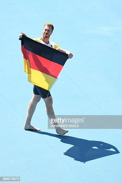 Gold medallist Germany's Christoph Harting celebrates after Men's Discus Throw Final during the athletics event at the Rio 2016 Olympic Games at the...