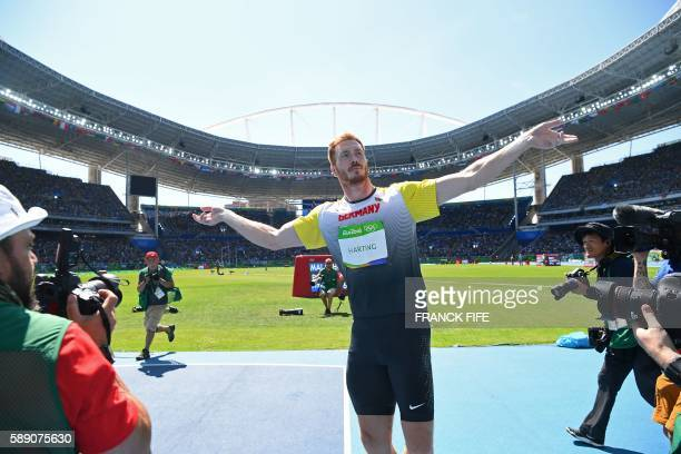 TOPSHOT Gold medallist Germany's Christoph Harting celebrates winning the Men's Discus Throw Final during the athletics event at the Rio 2016 Olympic...