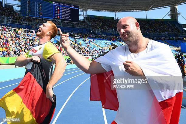 TOPSHOT Gold medallist Germany's Christoph Harting celebrates with silver medallist Poland's Piotr Malachowski after the Men's Discus Throw Final...