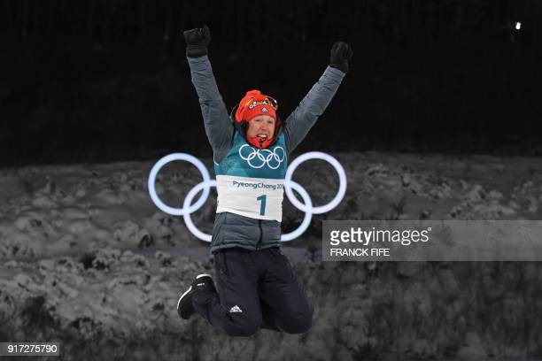 TOPSHOT Gold medallist Germany's Laura Dahlmeier celebrates on the podium during the victory ceremony in the women's 10km pursuit biathlon event...