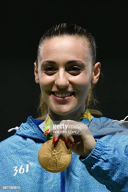 Gold medallist Greece's Anna Korakaki poses on the podium during the medal ceremony of the women's 25m pistol shooting event at the Rio 2016 Olympic...