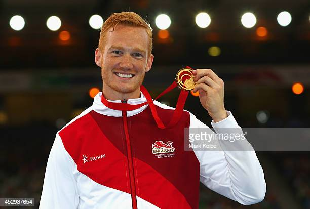 Gold medallist Greg Rutherford of England poses on the podium during the medal ceremony for the Men's Long Jump at Hampden Park during day seven of...