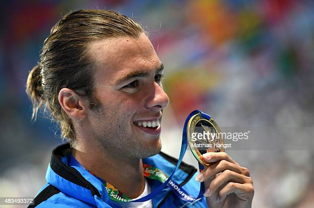 Gold medallist Gregorio Paltrinieri of Italy poses during the medal ceremony for the Men's 1500m Freestyle Final on day sixteen of the 16th FINA...