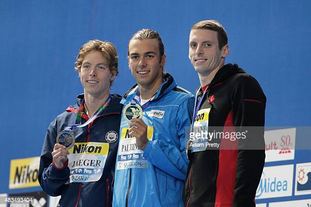 Gold medallist Gregorio Paltrinieri of Italy poses with silver medallist Connor Jaeger of the United States and bronze medallist Ryan Cochrane of...