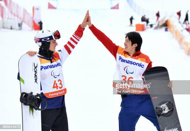 Gold medallist Gurimu Narita of Japan and Silver medallist Evan Strong of USA celebrate at the victory ceremony for the Men's Banked Slalom SBLL2...