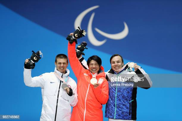 Gold medallist Gurimu Narita of Japan Silver medallist Evan Strong of USA and Bronze medallist Matti SuurHamari of Finland celebrate during the medal...