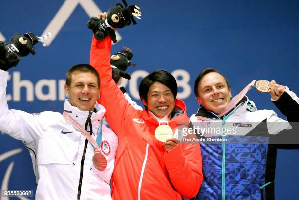 Gold medallist Gurimu Narita of Japan Silver medallist Evan Strong of USA and Bronze medallist Matti SuurHamari of Finland competes in the Men's...