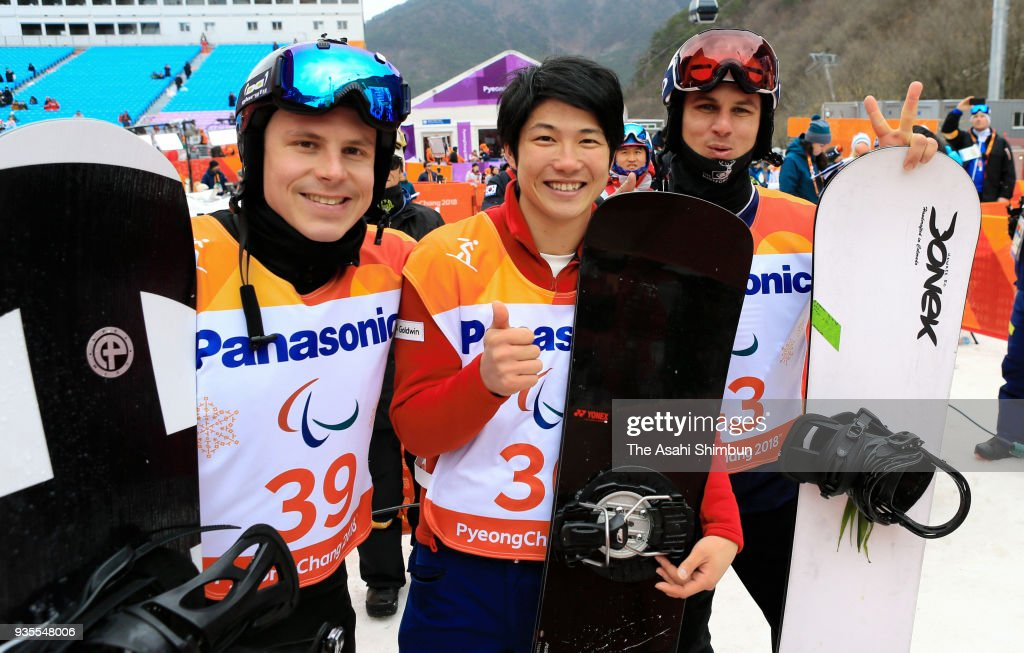 Gold medallist Gurimu Narita of Japan (C), Silver medallist Evan Strong of USA (R) and Bronze medallist Matti Suur-Hamari (L) of Finland celebrate at the victory ceremony for the Men's Banked Slalom SB-LL2 during day seven of the PyeongChang 2018 Paralympic Games on March 16, 2018 in Pyeongchang-gun, South Korea.