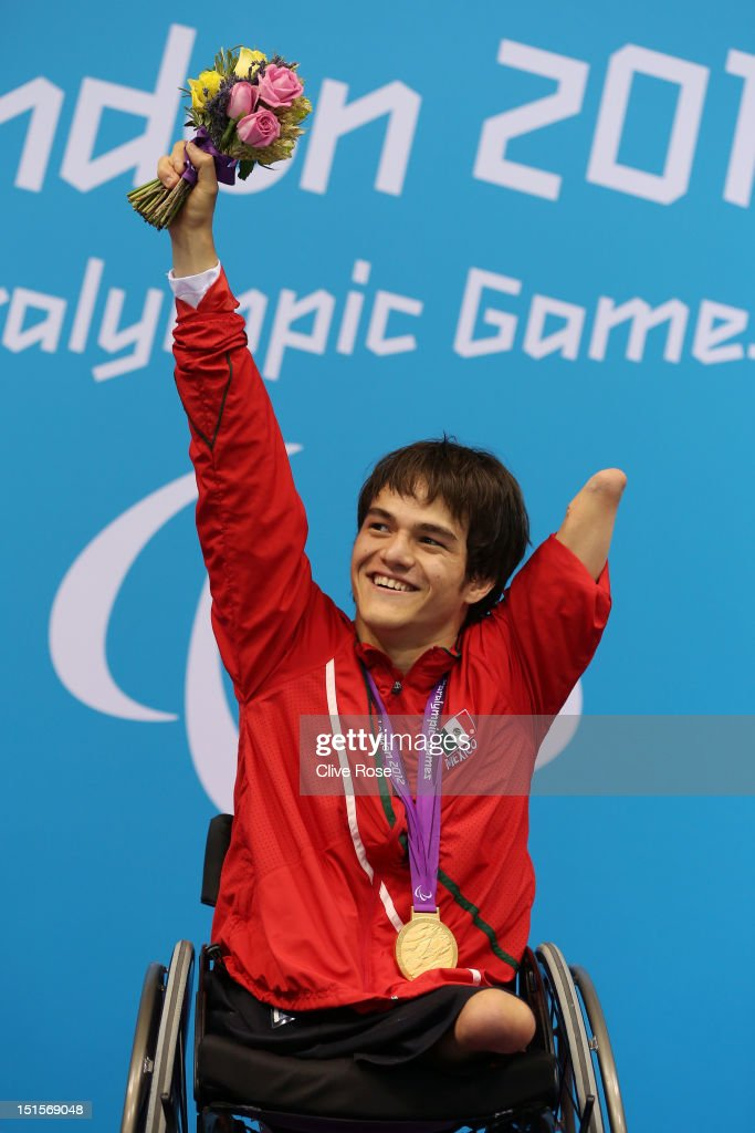 Gold medallist Gustavo Sanchez Martinez of Mexico poses on the podium during the medal ceremony for the Men's 200m Freestyle - S4 final on day 10 of the London 2012 Paralympic Games at Aquatics Centre on September 8, 2012 in London, England.
