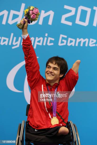Gold medallist Gustavo Sanchez Martinez of Mexico poses on the podium during the medal ceremony for the Men's 200m Freestyle S4 final on day 10 of...