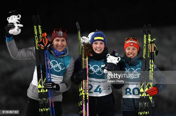 Gold medallist Hanna Oeberg of Sweden poses with silver medalist Anastasiya Kuzmina of Slovakia and bronze medallist Laura Dahlmeier of Germany...