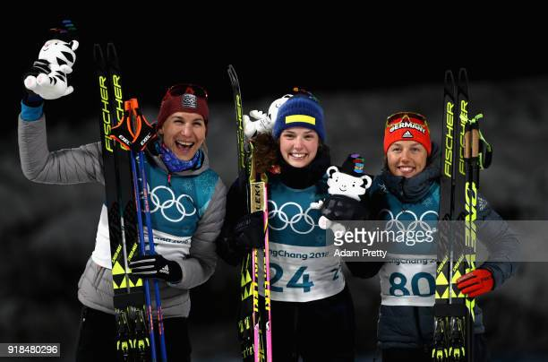 Gold medallist Hanna Oeberg of Sweden poses with silver medalist Anastasiya Kuzmina of Slovakia and bronze medallist Laura Dahlmeier of Germany...