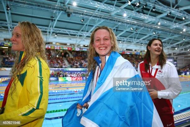 Gold medallist Hannah Miley of Scotland smiles with Silver medallist Aimee Willmott of England and Bronze medallist Keryn McMaster of Australia after...