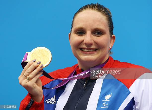 Gold medallist Heather Frederiksen of Great Britain poses on the podium during the medal ceremony for the Women's 100m Backstroke S8 finalon day 6 of...