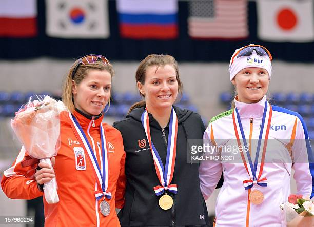 Gold medallist Heather Richardson of the US silver medallist Christine Nesbitt of Canada and Lotte van Beek of the Netherlands celebrate on the...